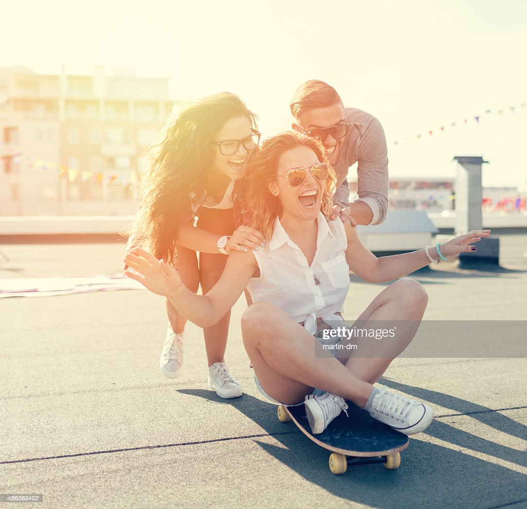 Teenagers skateboarding on the rooftop
