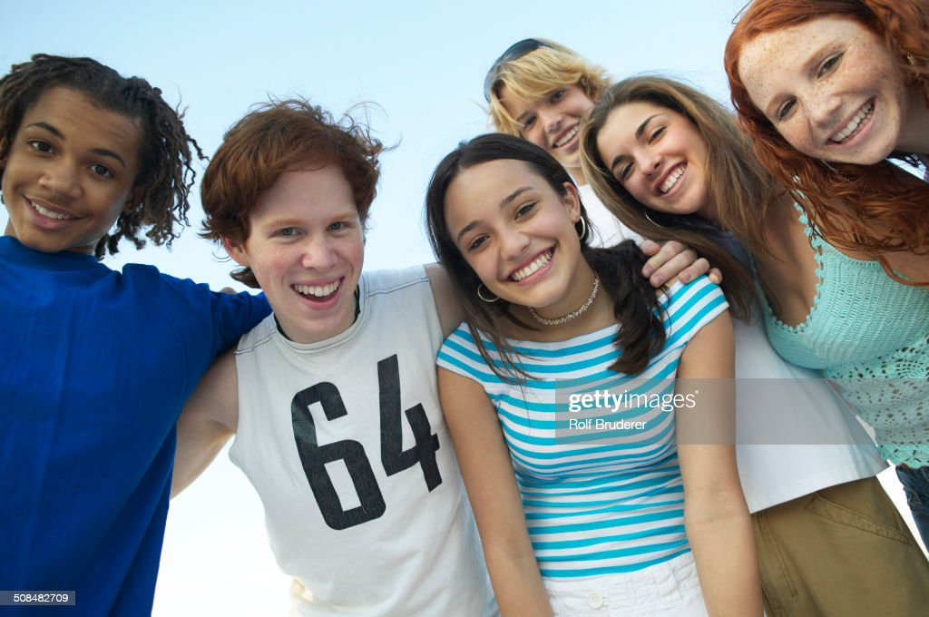 Teenagers standing together outdoors