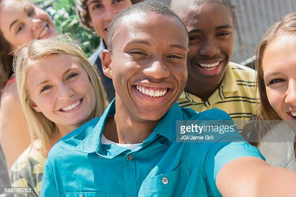 Teenagers taking selfie together outdoors