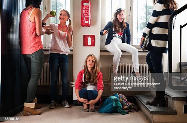 Teenagers talking in school hallway