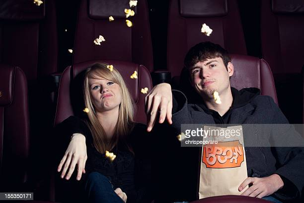 Teenagers Throwing Popcorn at the Movie Screen