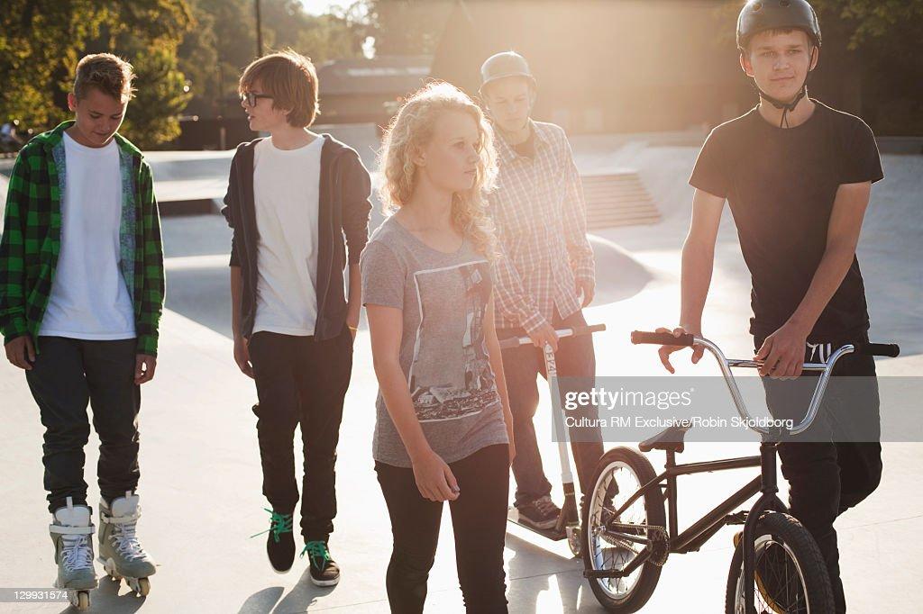 Teenagers walking at skate park : Stock Photo