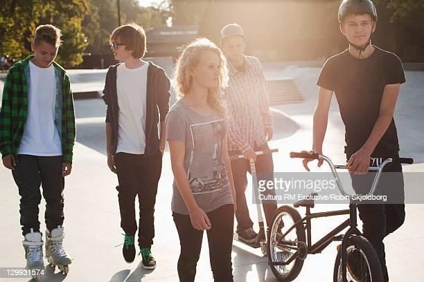 Teenagers walking at skate park