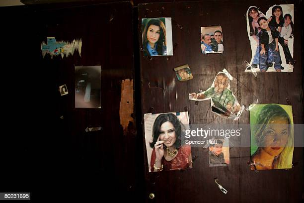 A teenager's wall displays photos of pop stars at a home that is currently unoccupied in a neighborhood that has been heavily afflicted by fighting...
