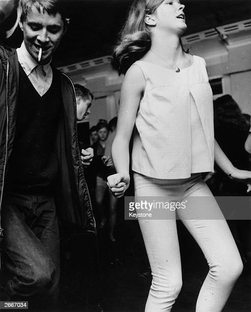 Teenagers wearing typical 'Mod' clothing including the classic Parker coat dancing 'The Stomp' in a club in Sydney