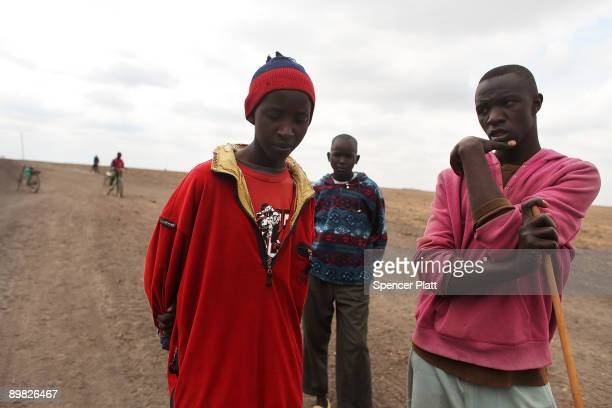 Teenagers who are members of the Maasai ethnic group walk with their cattle in search of grassland to graze their herd on August 16 2009 in Kisaju...
