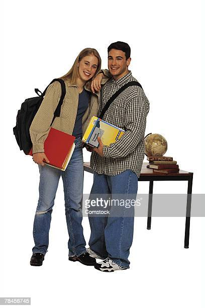 Teenagers with book bags