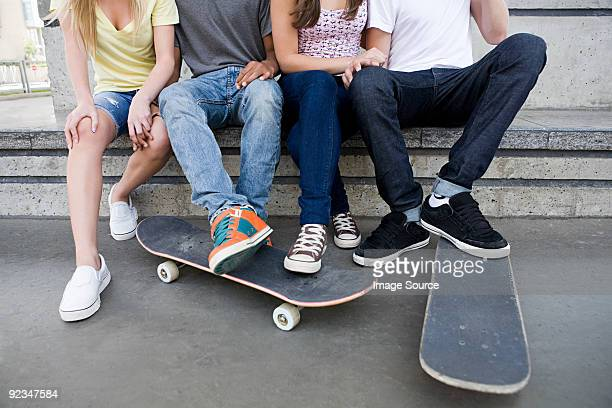Teenagers with skateboards