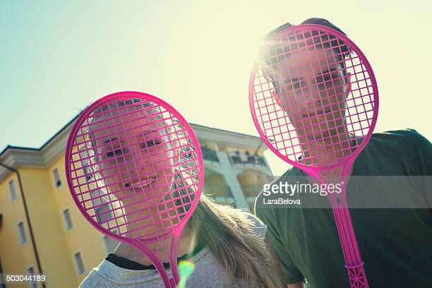 Teenagers with squash rackets