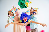 Group of teens on a birthday party with clowns