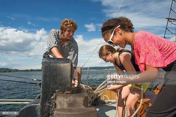 Teens help on sailboat