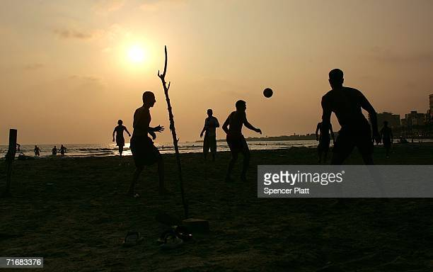 Teens play a game of soccer on the beach August 20 2006 in Tyre Lebanon While a shaky cease fire between Israel and Hezbollah still holds funerals...