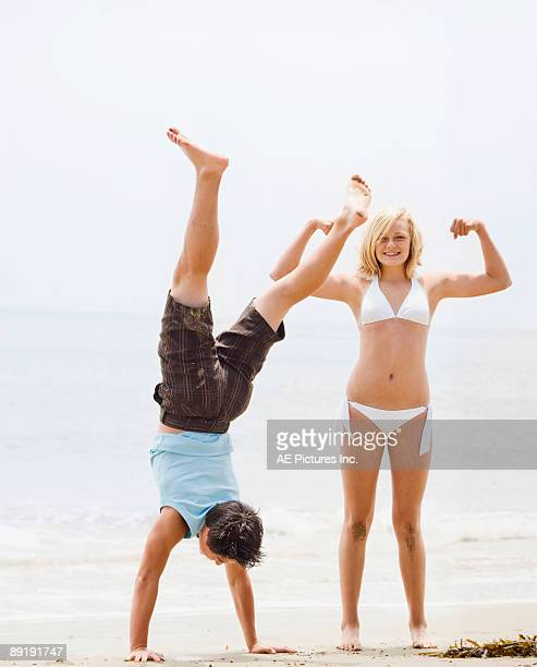 Teens play on the beach