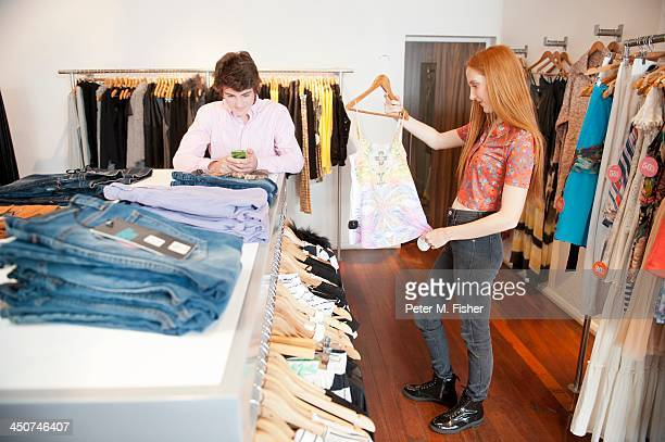 Teens (16-17) shopping for clothes