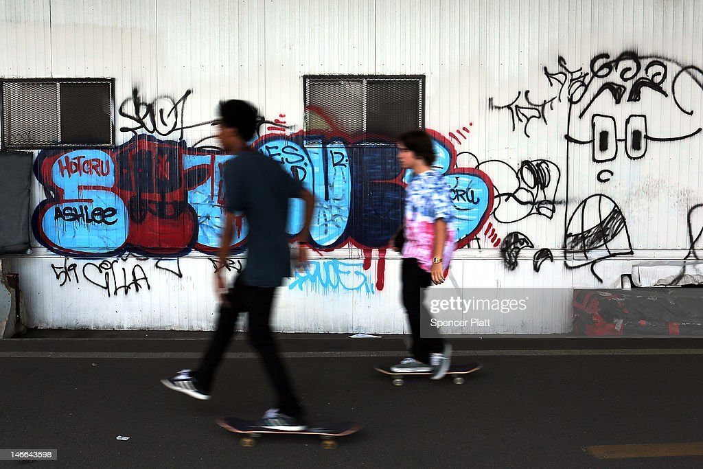 Teens skateboard along a shady underpass on the East River during record breaking heat on June 21, 2012 in New York City. New York City and much of the East Coast have been experiencing a second day of hot weather with temperatures of 98 degrees Fahrenheit (37 Celsius) being predicted in Central Park. High heat warnings and air quality alerts have been issued from Quebec to Virginia. Temperatures are not expected to cool down until the start of next week.