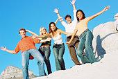 Teens standing on a rock