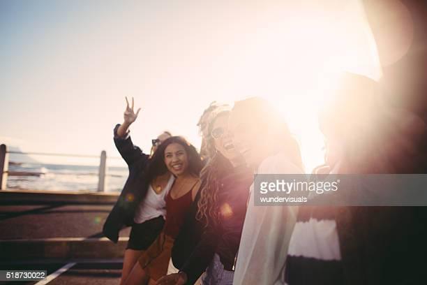 Teens taking a selfie outdoors at seaside