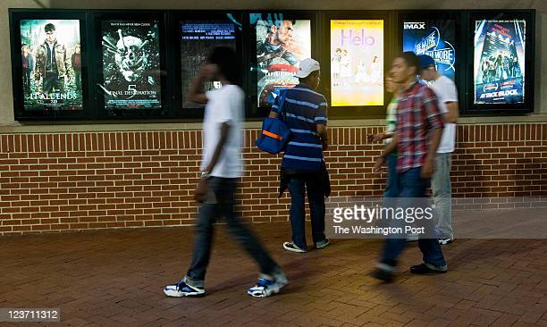 Teens walk past the movie posters at the movie theater on Ellsworth Drive Montgomery county is currently debating whether to have a curfew Downtown...