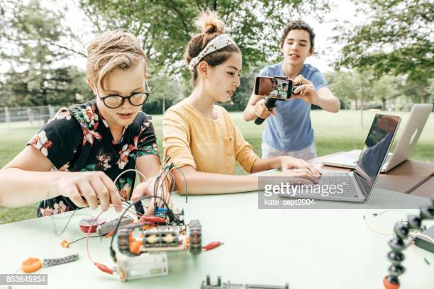 Teens working on robotics project