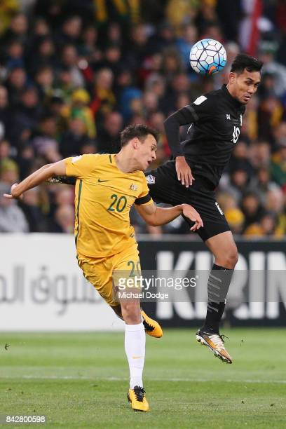 Teerasil Dangda of Thailand heads the ball over Trent Sainsbury of the Socceroos during the 2018 FIFA World Cup Qualifier match between the...