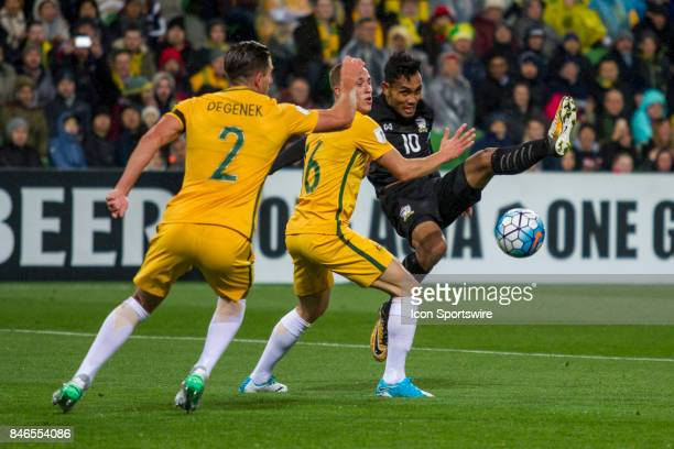 Teerasil Dangda of the Thailand National Football Team and Alexander Gersbach of the Australian National Football Team contest the ball during the...