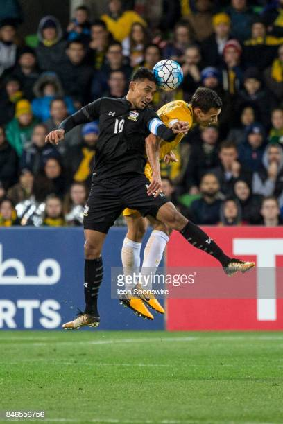 Teerasil Dangda of the Thailand National Football Team and Trent Sainsbury of the Australian National Football Team contest the ball during the FIFA...