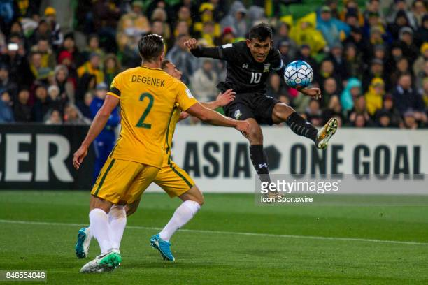 Teerasil Dangda of the Thailand National Football Team clears the ball during the FIFA World Cup Qualifier Match Between the Australian National...
