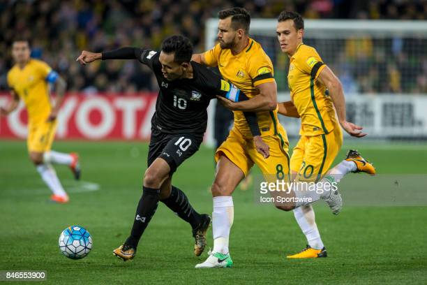 Teerasil Dangda of the Thailand National Football Team contest the ball with Bailey Wright of the Australian National Football Team and Trent...