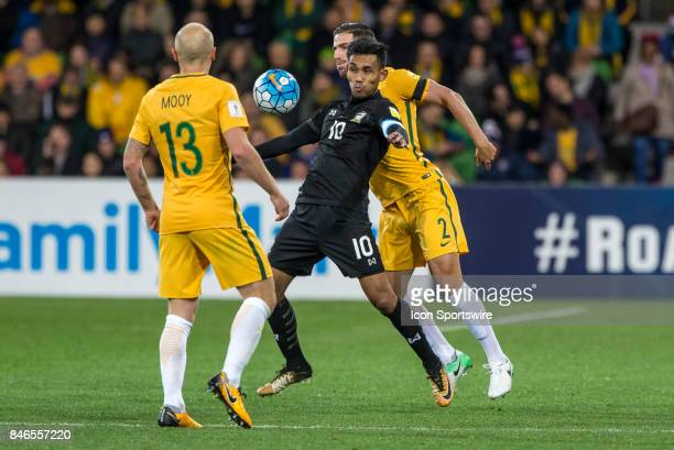 Teerasil Dangda of the Thailand National Football Team controls the ball in front of Milos Degenek of the Australian National Football Team during...