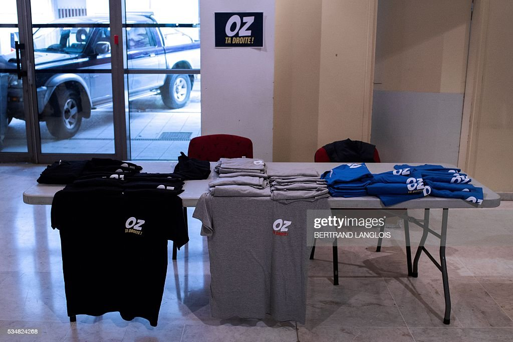 Tee-shirts reading 'Oz ta Droite' are displayed for sale at the municipal theatre in Beziers, southern France, on May 28, 2016, during 'Le Rendez-vous de Beziers' political meeting of Beziers' mayor Robert Menard. Menard launched his own political movement 'Oz ta Droite'. / AFP / BERTRAND