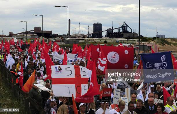 Teeside Steelworkers with supporters and their families march through Redcar to highlight the threat to the local Corus plant where a consortium of...