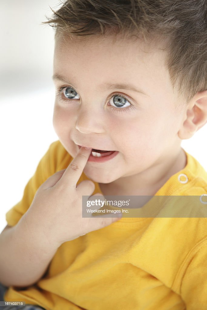 Teething signs and symptoms : Stock Photo