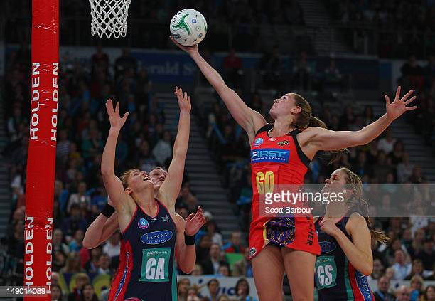 Tegan Caldwell of the Vixens and Casey Williams of the Magic compete for the ball during the ANZ Championship Grand Final match between the Melbourne...