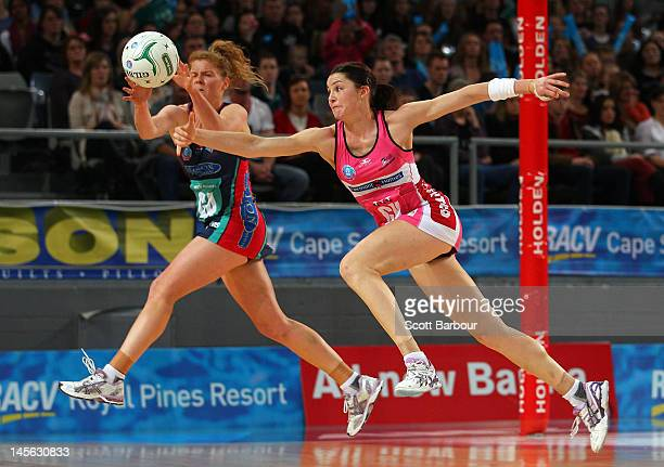Tegan Caldwell of the Vixens and Sharni Layton of the Thunderbirds compete for the ball during the round 10 ANZ Championship match between the Vixens...