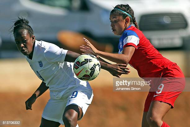 Tegan McGrady of USA and Danielle Carter of England fight for the ball during the women's U23 international friendly match between USA U20 and...