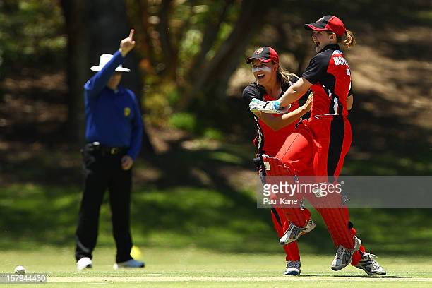 Tegan McPharlin and Alex Price of the Scorpions celebrate the run out of Chloe Piparo of the Fury during the WNCL match between the Western Australia...