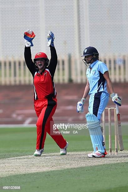 Tegan McPharlin of SA Scorpions celebrates the wicket of Laura Marsh of NSW Breakers during the WNCL Final match between the New South Wales and...