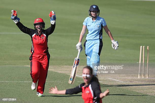 Tegan McPharlin of the SA Scorpians celebrates as Lauren Cheatle of NSW Breakers is given out during the WNCL Final match between the New South Wales...
