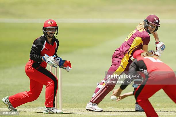 Tegan McPharlin of the Scorpions watches as Alex Price drops a catch off Holly Ferling of the Fire during the WNCL match between South Australia and...