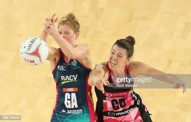 Tegan Philip of the Vixens and Fiona Themann of the Thunderbirds compete for the ball during the round 13 Super Netball match between the Vixens and...