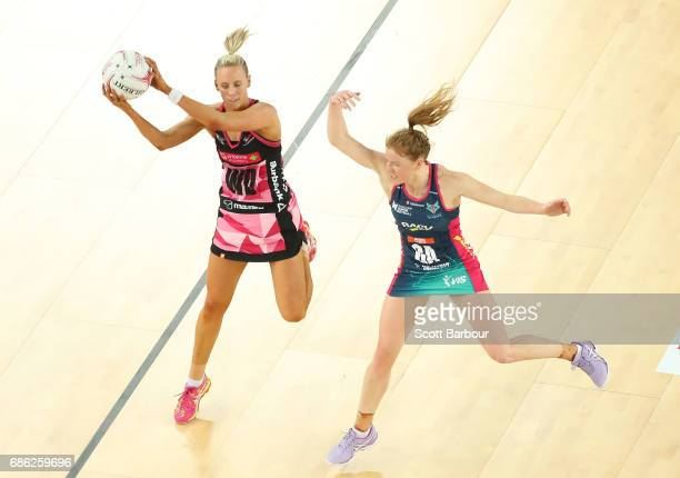 Tegan Philip of the Vixens and Renae Ingles of the Thunderbirds compete for the ball during the round 13 Super Netball match between the Vixens and...