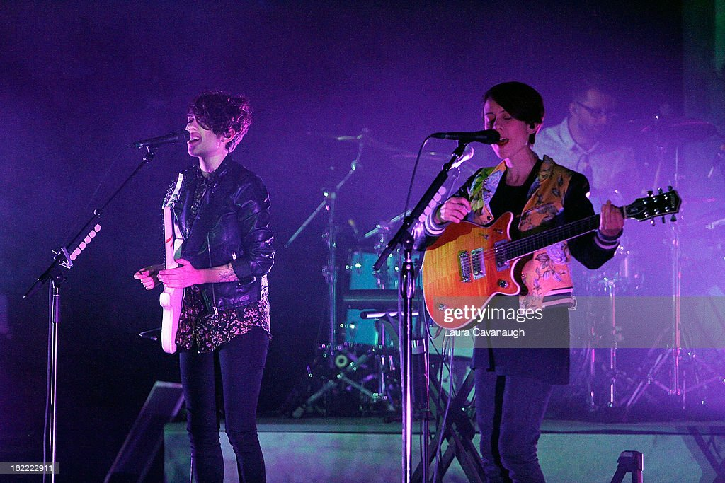 Tegan Quin and Sara Quin of Tegan and Sara perform at the Beacon Theatre on February 20, 2013 in New York City.