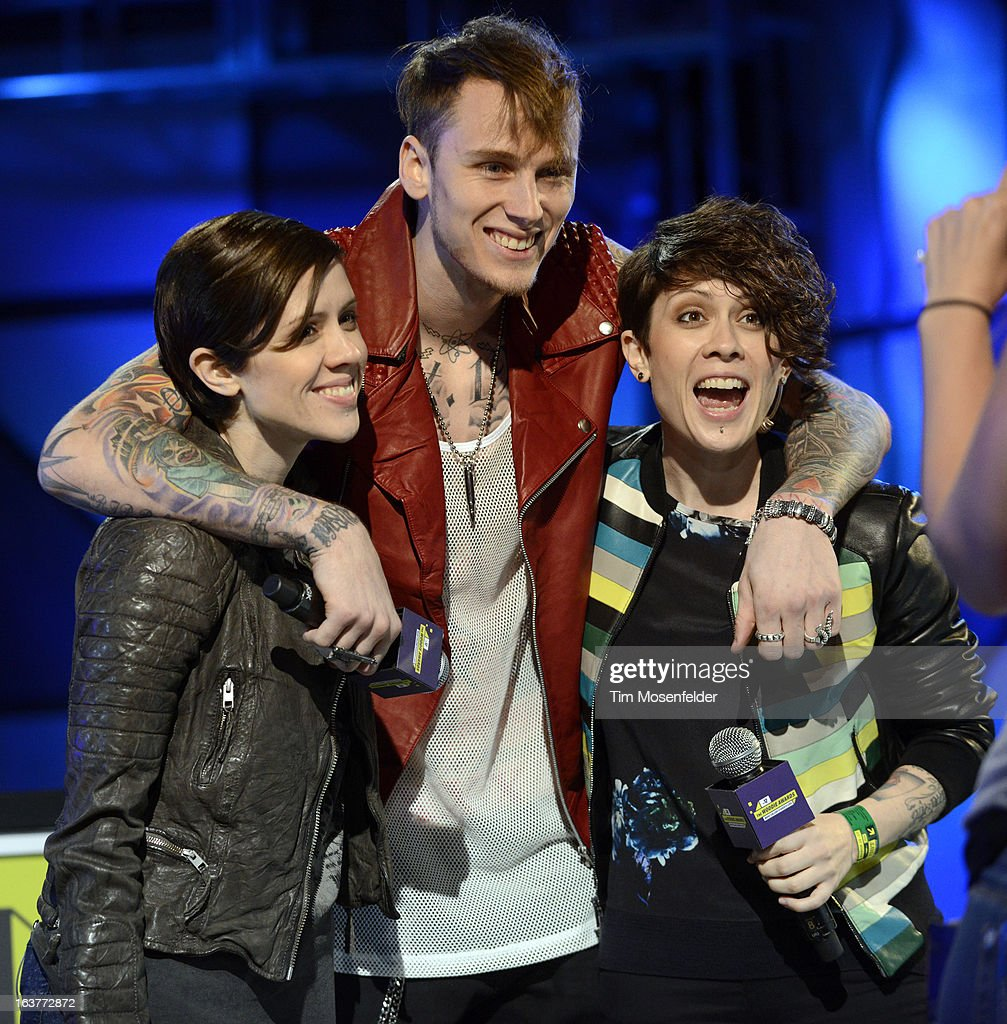 <a gi-track='captionPersonalityLinkClicked' href=/galleries/search?phrase=Tegan+Quin&family=editorial&specificpeople=2351694 ng-click='$event.stopPropagation()'>Tegan Quin</a>, Machine Gun Kelly, and <a gi-track='captionPersonalityLinkClicked' href=/galleries/search?phrase=Sara+Quin&family=editorial&specificpeople=2303840 ng-click='$event.stopPropagation()'>Sara Quin</a> perform at the mtvU Woodie Awards on March 14, 2013 in Austin, Texas.