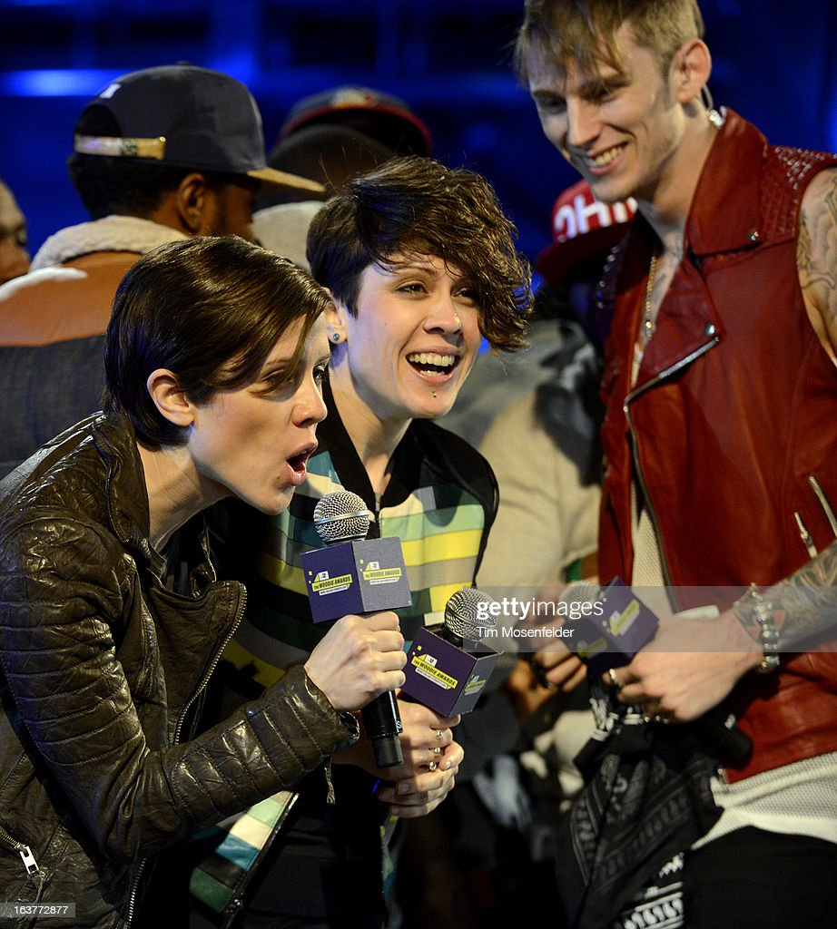 Tegan Quin, Sara Quin, and Machine Gun Kelly perform at the mtvU Woodie Awards on March 14, 2013 in Austin, Texas.