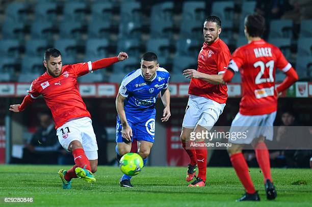 Tegi Savanier and Anthony Marin of Nimes and Neal Maupay of Brest during the French LIgue 2 match between Nimes and Brest at Stade des Costieres on...
