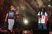 Tego Calderon performs with Rene Perez of Calle 13 as part of his concert 'La Trayectoria' at Coliseo Jose M Agrelot on August 28 2015 in San Juan...