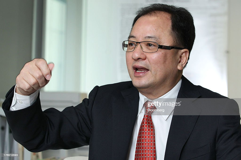 Teh Kean Ming, managing director and chief executive officer of IJM Corp., gestures as he speaks during an interview in Kuala Lumpur, Malaysia, on Monday, Aug. 19, 2013. IJM is looking to expand in Indonesia and Myanmar, and sees opportunities for growth in Malaysia, Teh said. Photographer: Goh Seng Chong/Bloomberg via Getty Images