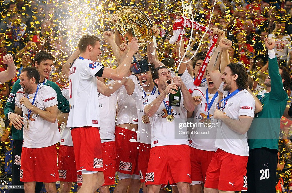 Teh team of Denmark celebrates with the EHFR tropy after winning 21-19 the Men's European Handball Championship final match between Serbia and Denmark at Beogradska Arena on January 29, 2012 in Belgrade, Serbia.