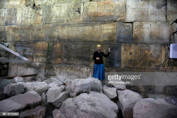 Tehillah Lieberman an archeologist of the Israeli Antiquity Authority shows journalists a recently discovered new part of the Western Wall tunnels in...