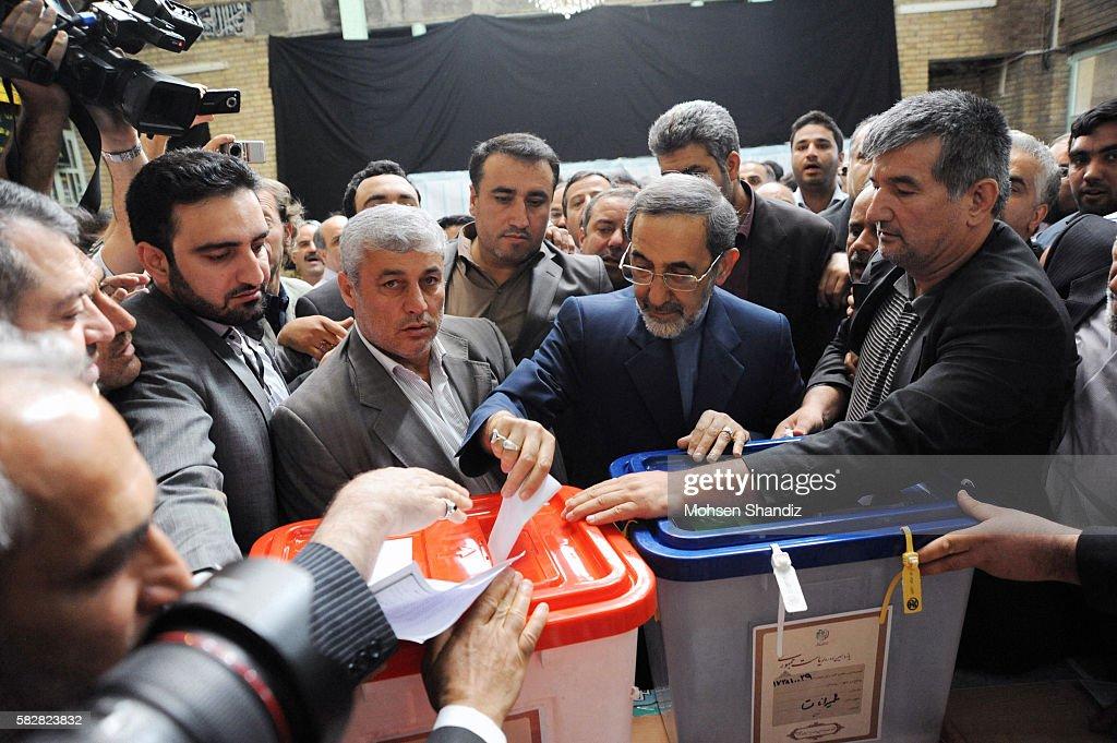 A supporter of Iranian advisor to the supreme leader Ayatollah Ali Khamenei and hopeful conservative presidential candidate Ali Akbar Velayati shows...